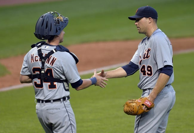 Sep 1, 2014; Cleveland, OH, USA; Detroit Tigers relief pitcher Jim Johnson (49) and catcher James McCann celebrate a 12-1 win over the Cleveland Indians at Progressive Field. Mandatory Credit: David Richard-USA TODAY Sports