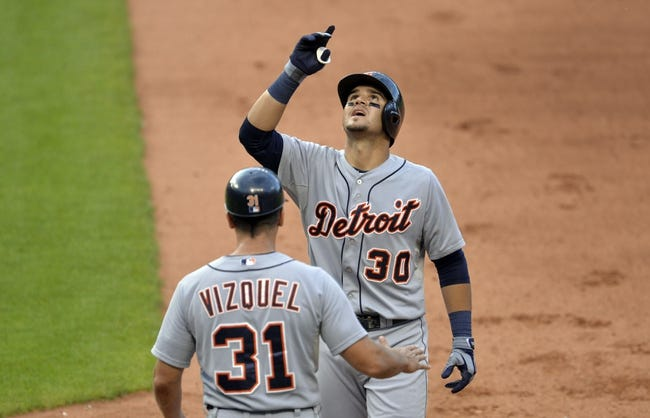 Sep 1, 2014; Cleveland, OH, USA; Detroit Tigers shortstop Eugenio Suarez (30) celebrates an RBI single in the seventh inning against the Cleveland Indians at Progressive Field. Mandatory Credit: David Richard-USA TODAY Sports