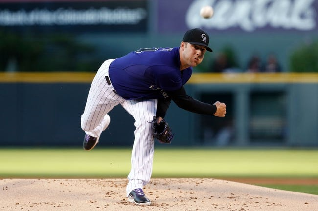 Sep 2, 2014; Denver, CO, USA; Colorado Rockies starting pitcher Jordan Lyles (24) pitches in the first inning against the San Francisco Giants at Coors Field. Mandatory Credit: Isaiah J. Downing-USA TODAY Sports