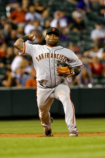 Sep 2, 2014; Denver, CO, USA; San Francisco Giants third baseman Pablo Sandoval (48) fields the ball in the fifth inning against the Colorado Rockies at Coors Field. Mandatory Credit: Isaiah J. Downing-USA TODAY Sports