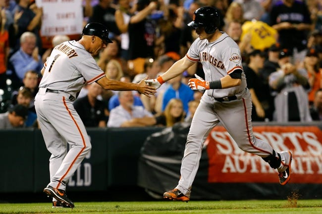 Sep 2, 2014; Denver, CO, USA; San Francisco Giants catcher Andrew Susac (34) celebrates with third base coach Tim Flannery (1) after hitting a two run home run in the sixth inning against the Colorado Rockies at Coors Field. Mandatory Credit: Isaiah J. Downing-USA TODAY Sports
