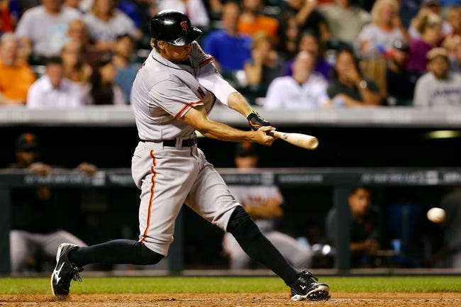 Sep 2, 2014; Denver, CO, USA; San Francisco Giants right fielder Hunter Pence (8) hits a single in the sixth inning against the Colorado Rockies at Coors Field. Mandatory Credit: Isaiah J. Downing-USA TODAY Sports