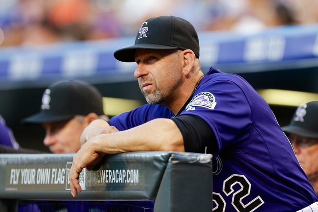 Sep 2, 2014; Denver, CO, USA; Colorado Rockies manager Walt Weiss (22) in the first inning against the San Francisco Giants at Coors Field. Mandatory Credit: Isaiah J. Downing-USA TODAY Sports