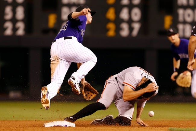 Sep 2, 2014; Denver, CO, USA; San Francisco Giants right fielder Hunter Pence (8) steals second against Colorado Rockies short stop Josh Rutledge (14) in the eighth inning at Coors Field. Mandatory Credit: Isaiah J. Downing-USA TODAY Sports