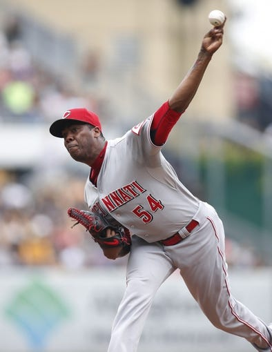 Aug 31, 2014; Pittsburgh, PA, USA; Cincinnati Reds relief pitcher Aroldis Chapman (54) pitches against the Pittsburgh Pirates during the ninth inning at PNC Park. The Reds won 3-2. Mandatory Credit: Charles LeClaire-USA TODAY Sports