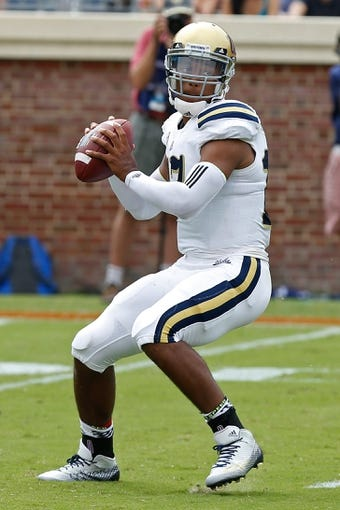 Aug 30, 2014; Charlottesville, VA, USA; UCLA Bruins quarterback Brett Hundley (17) prepares to throw the ball against the Virginia Cavaliers at Scott Stadium. Mandatory Credit: Geoff Burke-USA TODAY Sports