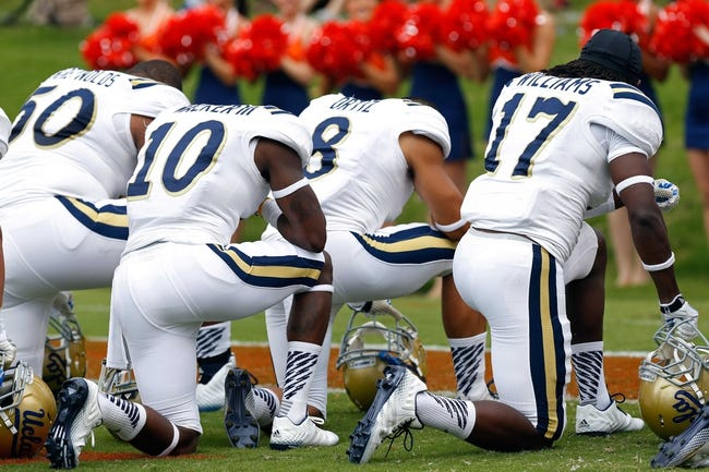Aug 30, 2014; Charlottesville, VA, USA; UCLA Bruins players kneel in the end zone prior to their game against the Virginia Cavaliers at Scott Stadium. Mandatory Credit: Geoff Burke-USA TODAY Sports