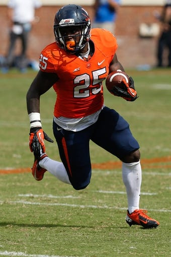 Aug 30, 2014; Charlottesville, VA, USA; Virginia Cavaliers running back Kevin Parks (25) carries the ball against the UCLA Bruins at Scott Stadium. Mandatory Credit: Geoff Burke-USA TODAY Sports