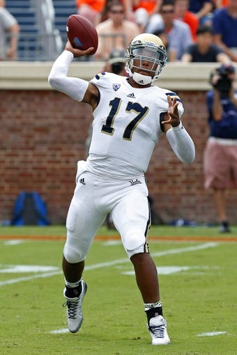 Aug 30, 2014; Charlottesville, VA, USA; UCLA Bruins quarterback Brett Hundley (17) throws the ball against the Virginia Cavaliers at Scott Stadium. Mandatory Credit: Geoff Burke-USA TODAY Sports
