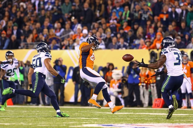Feb 2, 2014; East Rutherford, NJ, USA; Seattle Seahawks defensive back Kam Chancellor (31) intercepts the ball against the Denver Broncos in Super Bowl XLVIII at MetLife Stadium.  Mandatory Credit: Mark J. Rebilas-USA TODAY Sports