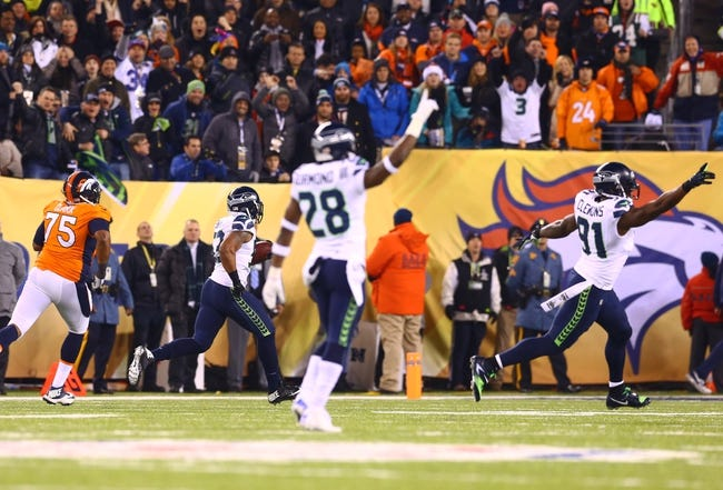 Feb 2, 2014; East Rutherford, NJ, USA; Seattle Seahawks linebacker Malcolm Smith (53) intercepts the ball and returns the interception for a touchdown against the Denver Broncos in Super Bowl XLVIII at MetLife Stadium.  Mandatory Credit: Mark J. Rebilas-USA TODAY Sports