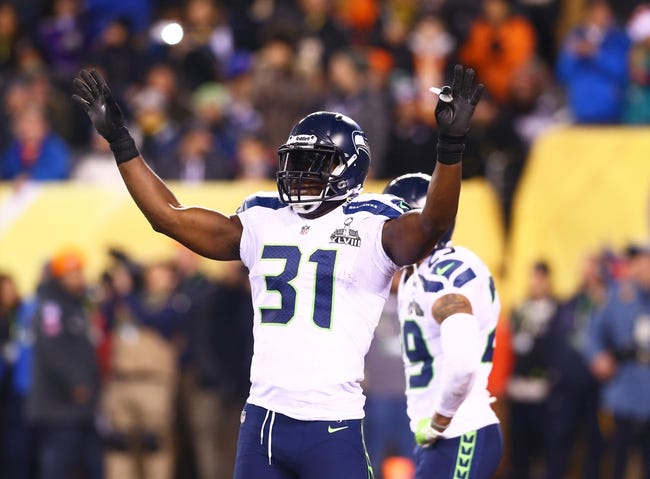Feb 2, 2014; East Rutherford, NJ, USA; Seattle Seahawks defensive back Kam Chancellor (31) reacts against the Denver Broncos in Super Bowl XLVIII at MetLife Stadium.  Mandatory Credit: Mark J. Rebilas-USA TODAY Sports