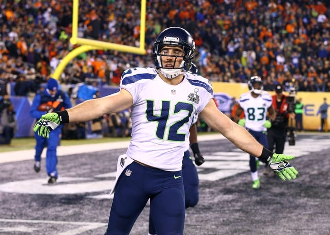 Feb 2, 2014; East Rutherford, NJ, USA; Seattle Seahawks defensive back Chris Maragos (42) celebrates a play against the Denver Broncos in Super Bowl XLVIII at MetLife Stadium.  Mandatory Credit: Mark J. Rebilas-USA TODAY Sports