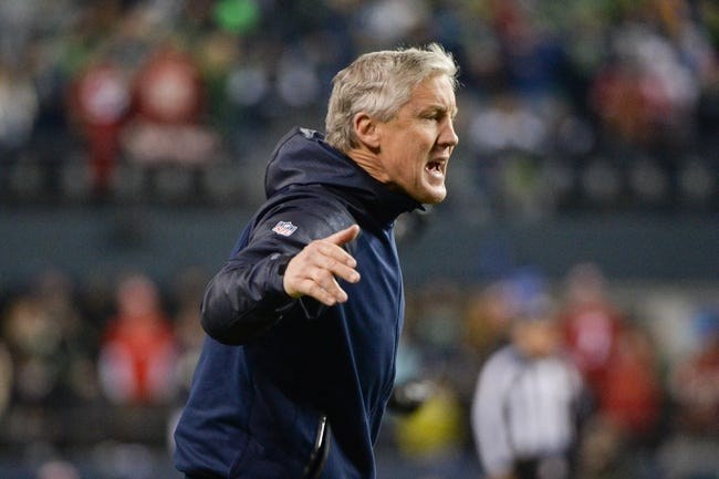 Jan 19, 2014; Seattle, WA, USA; Seattle Seahawks head coach Pete Carroll celebrates during the second half of the 2013 NFC Championship football game against the San Francisco 49ers at CenturyLink Field. The Seahawks defeated the 49ers 23-17. Mandatory Credit: Kyle Terada-USA TODAY Sports