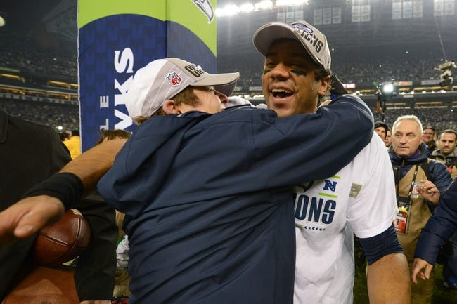Jan 19, 2014; Seattle, WA, USA; Seattle Seahawks quarterback Russell Wilson (3, back) celebrates with executive vice president & general manager John Schneider (front) after the 2013 NFC Championship football game against the San Francisco 49ers at CenturyLink Field. The Seahawks defeated the 49ers 23-17. Mandatory Credit: Kyle Terada-USA TODAY Sports