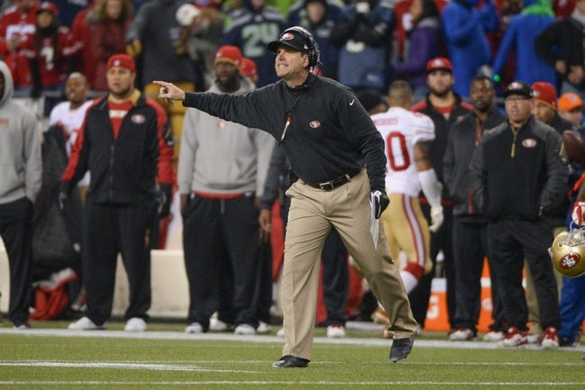Jan 19, 2014; Seattle, WA, USA; San Francisco 49ers head coach Jim Harbaugh argues during the second half of the 2013 NFC Championship football game against the Seattle Seahawks at CenturyLink Field. The Seahawks defeated the 49ers 23-17. Mandatory Credit: Kyle Terada-USA TODAY Sports