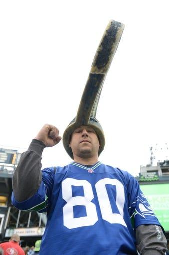 Jan 19, 2014; Seattle, WA, USA; Seattle Seahawks fan Matt Frey cheers before the 2013 NFC Championship football game against the San Francisco 49ers at CenturyLink Field. Mandatory Credit: Kyle Terada-USA TODAY Sports