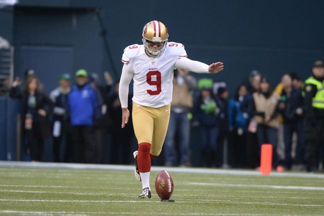 Jan 19, 2014; Seattle, WA, USA; San Francisco 49ers kicker Phil Dawson (9) kicks the football during the opening kickoff during the first half of the 2013 NFC Championship football game against the Seattle Seahawks at CenturyLink Field. The Seahawks defeated the 49ers 23-17. Mandatory Credit: Kyle Terada-USA TODAY Sports