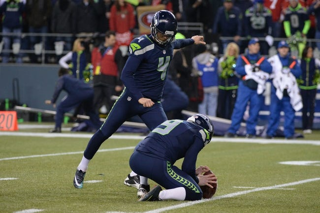 Jan 19, 2014; Seattle, WA, USA; Seattle Seahawks kicker Steven Hauschka (4) kicks a field goal out of the hold by punter Jon Ryan (9) during the second half of the 2013 NFC Championship football game against the San Francisco 49ers at CenturyLink Field. The Seahawks defeated the 49ers 23-17. Mandatory Credit: Kyle Terada-USA TODAY Sports