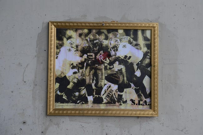 Jan 19, 2014; Seattle, WA, USA;  A framed photo of Seattle Seahawks running back Marshawn Lynch (24) 2011 touchdown on South Royal Brougham Way before the 2013 NFC Championship football game against the San Francisco 49ers at CenturyLink Field. The Seahawks defeated the 49ers 23-17. Mandatory Credit: Kyle Terada-USA TODAY Sports