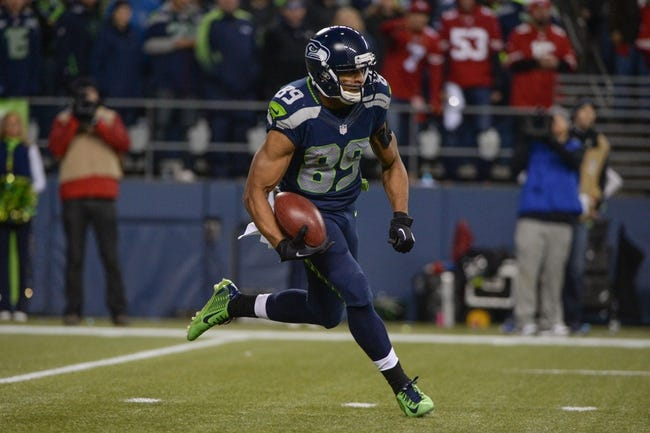Jan 19, 2014; Seattle, WA, USA; Seattle Seahawks wide receiver Doug Baldwin (89) runs with the football during the second half of the 2013 NFC Championship football game against the San Francisco 49ers at CenturyLink Field. The Seahawks defeated the 49ers 23-17. Mandatory Credit: Kyle Terada-USA TODAY Sports