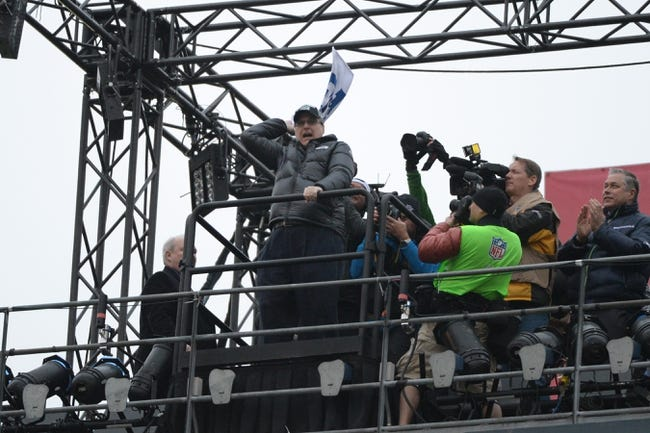 Jan 19, 2014; Seattle, WA, USA; Seattle Seahawks owner Paul Allen waves a towel while raising the 12th man flag before the 2013 NFC Championship football game against the San Francisco 49ers at CenturyLink Field. The Seahawks defeated the 49ers 23-17. Mandatory Credit: Kyle Terada-USA TODAY Sports
