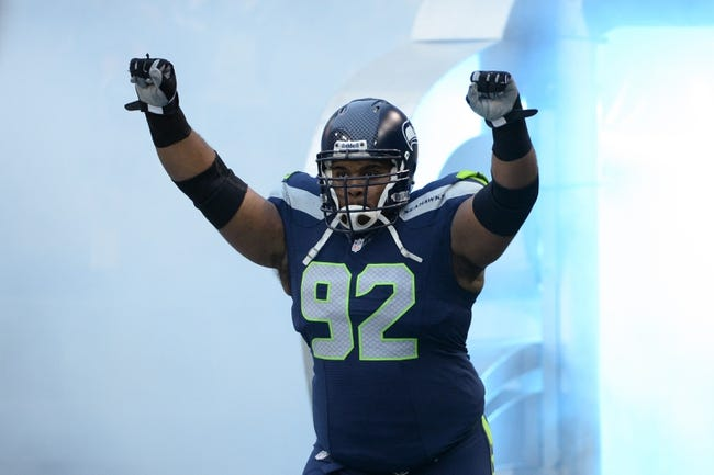 Jan 19, 2014; Seattle, WA, USA; Seattle Seahawks defensive tackle Brandon Mebane (92) runs onto the field during player introductions before the 2013 NFC Championship football game against the San Francisco 49ers at CenturyLink Field. The Seahawks defeated the 49ers 23-17. Mandatory Credit: Kyle Terada-USA TODAY Sports