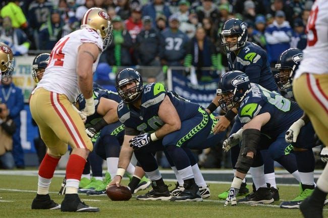 Jan 19, 2014; Seattle, WA, USA; Seattle Seahawks center Max Unger (60) prepares to snap the football to quarterback Russell Wilson (3) during the first half of the 2013 NFC Championship football game against the San Francisco 49ers at CenturyLink Field. The Seahawks defeated the 49ers 23-17. Mandatory Credit: Kyle Terada-USA TODAY Sports