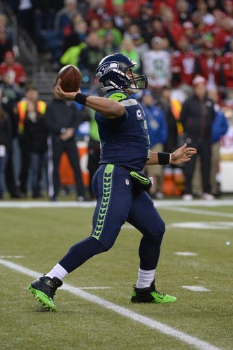 Jan 19, 2014; Seattle, WA, USA; Seattle Seahawks quarterback Russell Wilson (3) passes the football during the first half of the 2013 NFC Championship football game against the San Francisco 49ers at CenturyLink Field. The Seahawks defeated the 49ers 23-17. Mandatory Credit: Kyle Terada-USA TODAY Sports