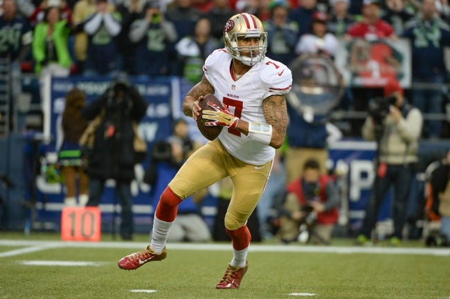 Jan 19, 2014; Seattle, WA, USA; San Francisco 49ers quarterback Colin Kaepernick (7) runs with the football during the first half of the 2013 NFC Championship football game against the Seattle Seahawks at CenturyLink Field. The Seahawks defeated the 49ers 23-17. Mandatory Credit: Kyle Terada-USA TODAY Sports