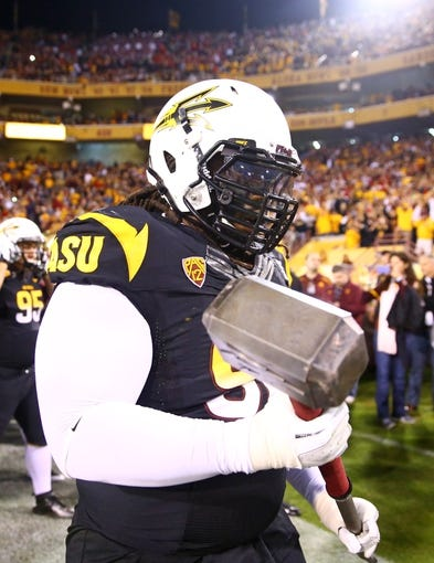Nov 30, 2013; Tempe, AZ, USA; Arizona State Sun Devils defensive tackle Will Sutton (90) holds a sledge hammer on the sidelines prior to the game against the Arizona Wildcats in the 87th annual Territorial Cup at Sun Devil Stadium. Mandatory Credit: Mark J. Rebilas-USA TODAY Sports