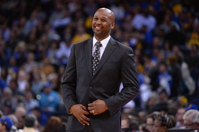 April 10, 2014; Oakland, CA, USA; Denver Nuggets head coach Brian Shaw smiles during the third quarter against the Golden State Warriors at Oracle Arena. The Nuggets defeated the Warriors 100-99. Mandatory Credit: Kyle Terada-USA TODAY Sports