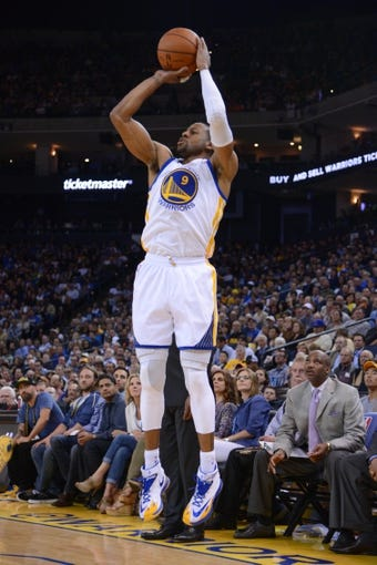 April 10, 2014; Oakland, CA, USA; Golden State Warriors forward Andre Iguodala (9) shoots the basketball during the fourth quarter against the Denver Nuggets at Oracle Arena. The Nuggets defeated the Warriors 100-99. Mandatory Credit: Kyle Terada-USA TODAY Sports