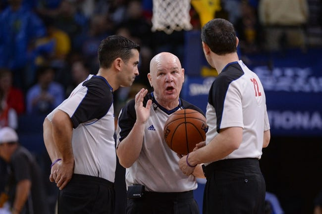 April 10, 2014; Oakland, CA, USA; NBA referee Joe Crawford (17, center) talks to referee Zach Zarba (28, left) and referee J.T. Orr (72, right) during the fourth quarter between the Golden State Warriors and the Denver Nuggets at Oracle Arena. The Nuggets defeated the Warriors 100-99. Mandatory Credit: Kyle Terada-USA TODAY Sports