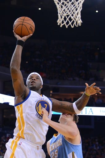 April 10, 2014; Oakland, CA, USA; Golden State Warriors center Jermaine O'Neal (7) shoots the basketball against Denver Nuggets center Timofey Mozgov (25) during the fourth quarter at Oracle Arena. The Nuggets defeated the Warriors 100-99. Mandatory Credit: Kyle Terada-USA TODAY Sports
