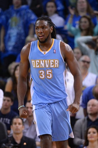 April 10, 2014; Oakland, CA, USA; Denver Nuggets forward Kenneth Faried (35) celebrates during the fourth quarter against the Golden State Warriors at Oracle Arena. The Nuggets defeated the Warriors 100-99. Mandatory Credit: Kyle Terada-USA TODAY Sports