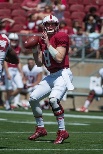 April 12, 2014; Stanford, CA, USA; Stanford Cardinal quarterback Kevin Hogan (8) passes the football during the spring game at Stanford Stadium. Mandatory Credit: Kyle Terada-USA TODAY Sports