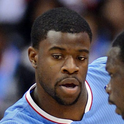 Nov 24, 2013; Los Angeles, CA, USA;  Chicago Bulls small forward gets around Los Angeles Clippers shooting guard Reggie Bullock (25) as he is screened during the first half of the game at Staples Center. Mandatory Credit: Jayne Kamin-Oncea-USA TODAY Sports