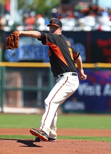 Mar 10, 2014; Scottsdale, AZ, USA; San Francisco Giants pitcher Matt Cain throws during the game against the Chicago Cubs at Scottsdale Stadium. Mandatory Credit: Mark J. Rebilas-USA TODAY Sports