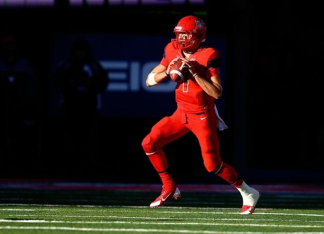 Nov 23, 2013; Tucson, AZ, USA; Arizona Wildcats quarterback B.J. Denker (7) against the Oregon Ducks at Arizona Stadium. Mandatory Credit: Mark J. Rebilas-USA TODAY Sports