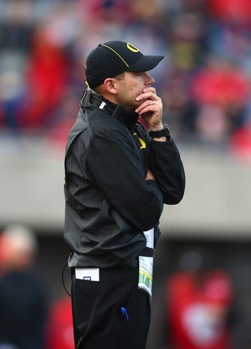 Nov 23, 2013; Tucson, AZ, USA; Oregon Ducks head coach Mark Helfrich reacts against the Arizona Wildcats at Arizona Stadium. Mandatory Credit: Mark J. Rebilas-USA TODAY Sports
