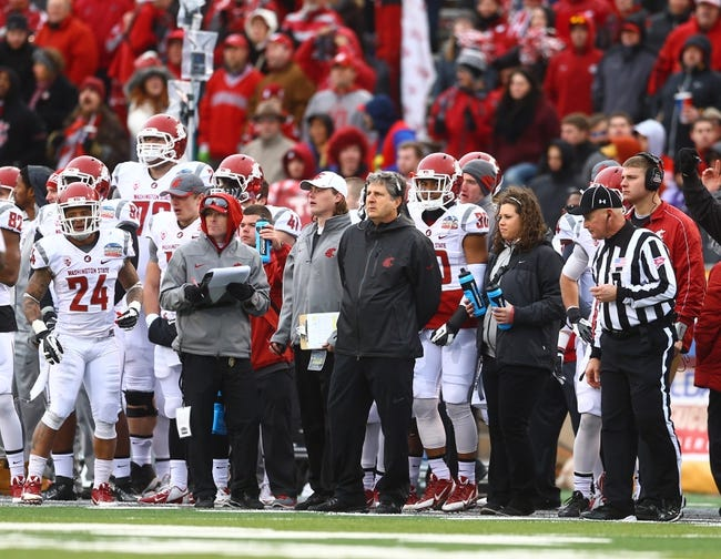 Dec 21, 2013; Albuquerque, NM, USA; Washington State Cougars head coach Mike Leach (center) on the sidelines against the Colorado State Rams during the Gildan New Mexico Bowl at University Stadium. Mandatory Credit: Mark J. Rebilas-USA TODAY Sports