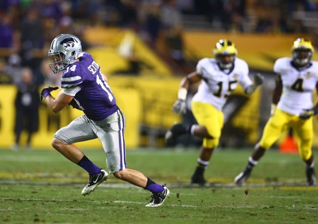 Dec 28, 2013; Tempe, AZ, USA; Kansas State Wildcats wide receiver Curry Sexton (14) against the Michigan Wolverines during the Buffalo Wild Wings Bowl at Sun Devil Stadium. Kansas State defeated Michigan 31-14. Mandatory Credit: Mark J. Rebilas-USA TODAY Sports