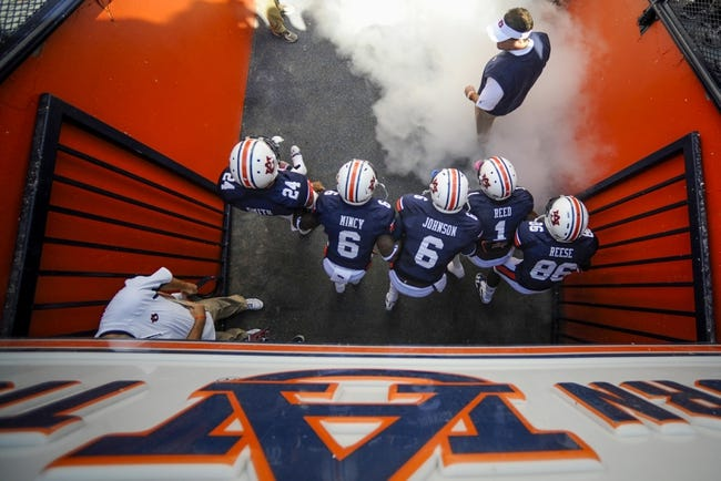 Oct 12, 2013; Auburn, AL, USA; Auburn Tigers head coach Gus Malzahn leads his team onto the field prior to the game against the Western Carolina Catamounts at Jordan Hare Stadium. Mandatory Credit: Shanna Lockwood-USA TODAY Sports