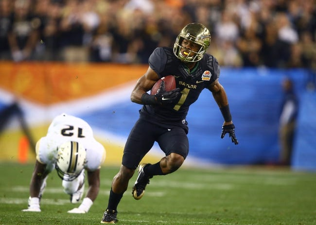 Jan 1, 2014; Glendale, AZ, USA; Baylor Bears wide receiver Corey Coleman (1) against the Central Florida Knights during the Fiesta Bowl at University of Phoenix Stadium. Mandatory Credit: Mark J. Rebilas-USA TODAY Sports