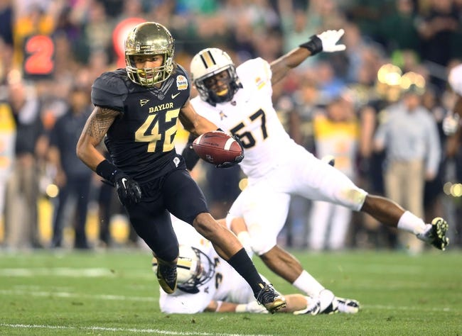 Jan 1, 2014; Glendale, AZ, USA; Baylor Bears wide receiver Levi Norwood (42) against the Central Florida Knights during the Fiesta Bowl at University of Phoenix Stadium. Mandatory Credit: Mark J. Rebilas-USA TODAY Sports