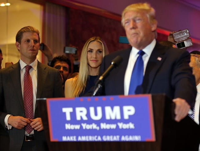 Apr 19, 2016; New York, NY, USA; Eric Trump (left) and his wife Lara Yunaska listen as his father Republican presidential hopeful Donald Trump speaks to supporters after the New York primary at Trump Tower. Mandatory Credit: Carucha L. Meuse/The Journal News via USA TODAY NETWORK