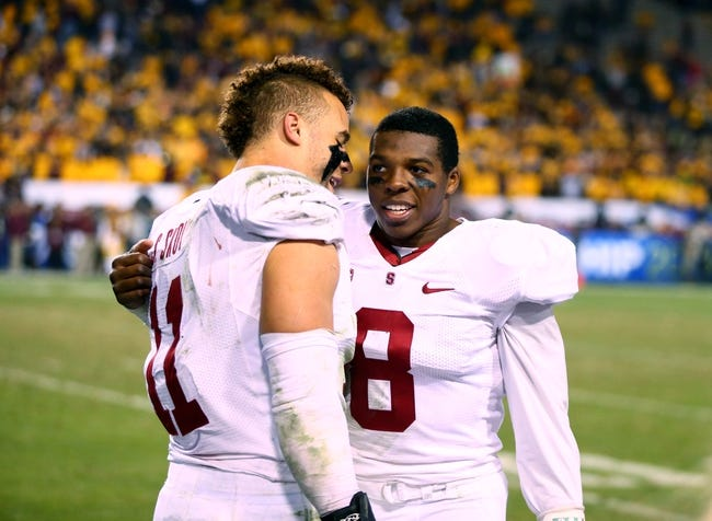 Dec 7, 2013; Tempe, AZ, USA; Stanford Cardinal linebacker Shayne Skov (11) celebrates with safety Jordan Richards (8) against the Arizona State Sun Devils at Sun Devil Stadium. Stanford defeated Arizona State 38-14. Mandatory Credit: Mark J. Rebilas-USA TODAY Sports
