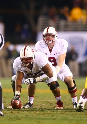 Dec 7, 2013; Tempe, AZ, USA; Stanford Cardinal quarterback Kevin Hogan (8) prepares to take the snap from center Khalil Wilkes against the Arizona State Sun Devils at Sun Devil Stadium. Stanford defeated Arizona State 38-14. Mandatory Credit: Mark J. Rebilas-USA TODAY Sports