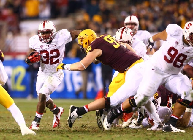 Dec 7, 2013; Tempe, AZ, USA; Stanford Cardinal running back Anthony Wilkerson (32) against the Arizona State Sun Devils at Sun Devil Stadium. Stanford defeated Arizona State 38-14. Mandatory Credit: Mark J. Rebilas-USA TODAY Sports